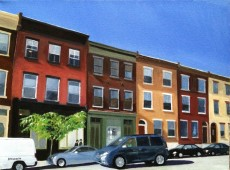 Street view of row houses and cars on Fairmount Avenue, Philadelphia