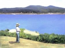 Woman in straw hat near water