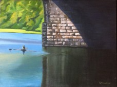 Rower leaving shadow of bridge, entering sunlight