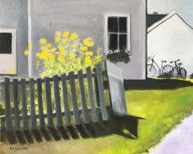 Yellow flowers and picket fence with house and bicycles in background