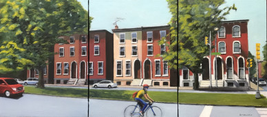 Row houses and bicyclist