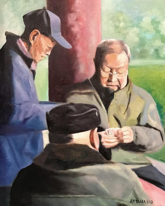 Elderly Chinese men playing cards in Beijing