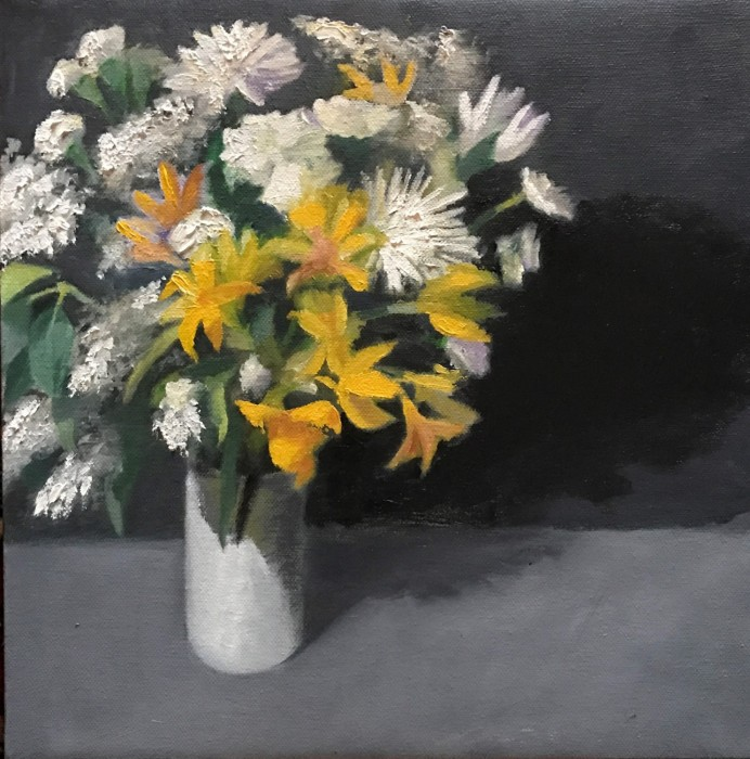 Bouquet of white and yellow flowers in white vase