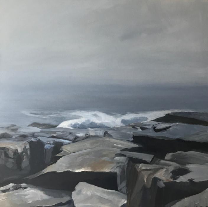 Waves crashing on rocks on a dark day