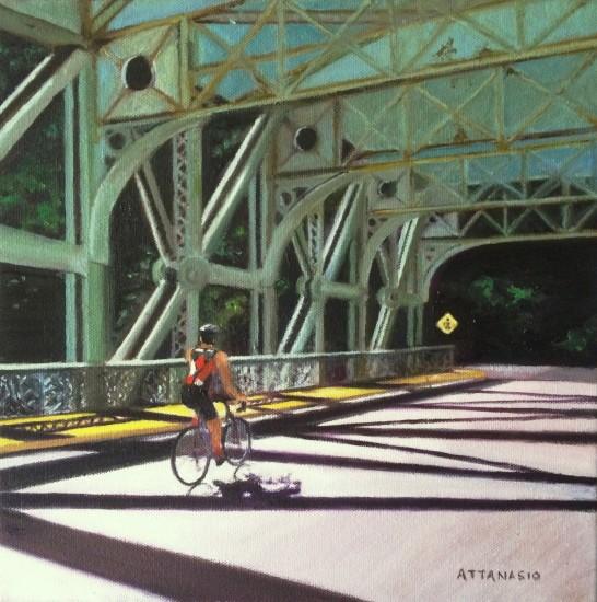 Bicyclist in sunshine crossing Falls Bridge over Schuylkill River, Philadelphia